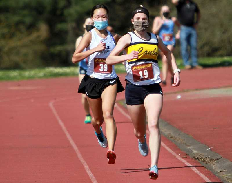 PMG PHOTO: MILES VANCE - Ashley Peterson runs to a fourth place finish at districts on Wednesday, March 31.