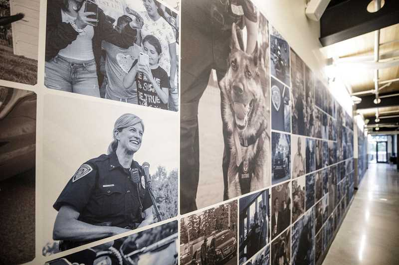 PMG PHOTO - A wall of photography adorns a hallway in the new Beaverton Public Safety Center, where the Beaverton Police Department operates from. One or more full-time BPD officers will be assigned to the Washington Countys mental health response team in the near future.