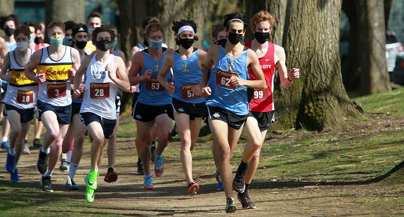 PMG PHOTO: MILES VANCE - Lakeridge's Maximus Chalpoutis (no. 62), Luke Loomis (no. 57) and Wilson Godfrey (no. 53) helped the Pacers win the Three Rivers League district meet at Portland's Fernhill Park on Wednesday, March 31.