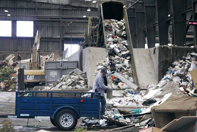 PMG FILE PHOTO: JONATHAN HOUSE - Recyclable goods are sorted and retrieved at a Metro transfer station before the rest is loaded into trailers destined for the Arlington Landfill.