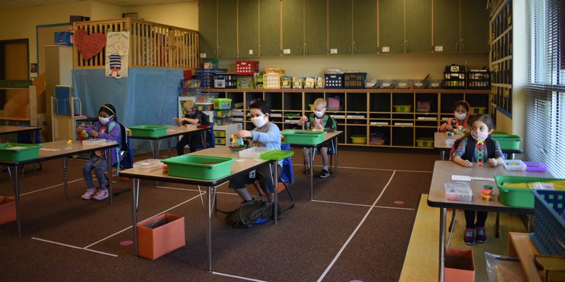 PMG PHOTO: TERESA CARSON - Emily Woolworth's first group of kindergartners settles in Thursday, April 1, at Hogan Cedars Elementary School in the Gresham-Barlow School District. The desks are spaced for safety and the 'loft' is off limits during the pandemic.