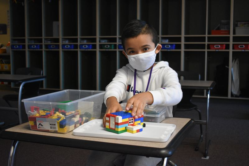 PMG PHOTO: TERESA CARSON - This Hogan Cedars student is starting his first day in the classroom with a construction project.