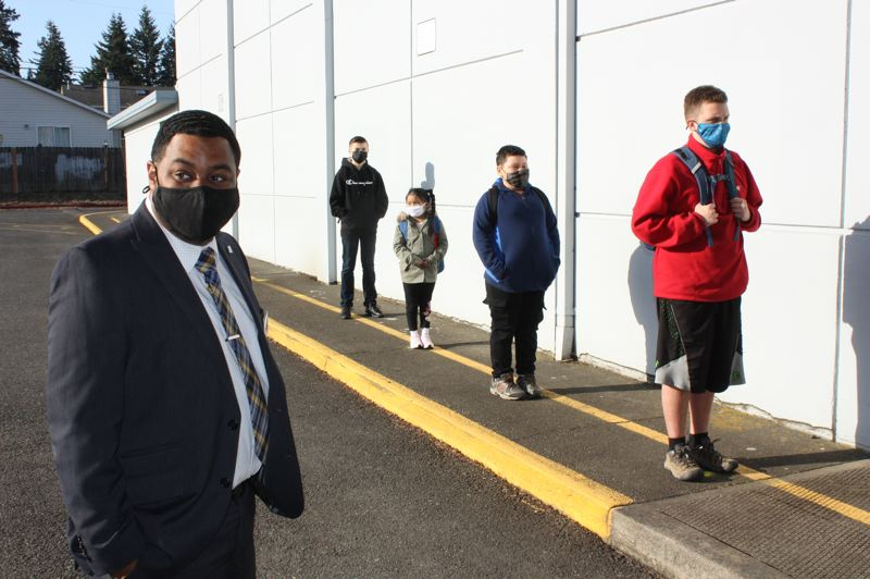 PMG PHOTO: TERESA CARSON - Centennial Superintendent Paul Coakley spends some time with students at Powell Butte Elementary School before they head into class.