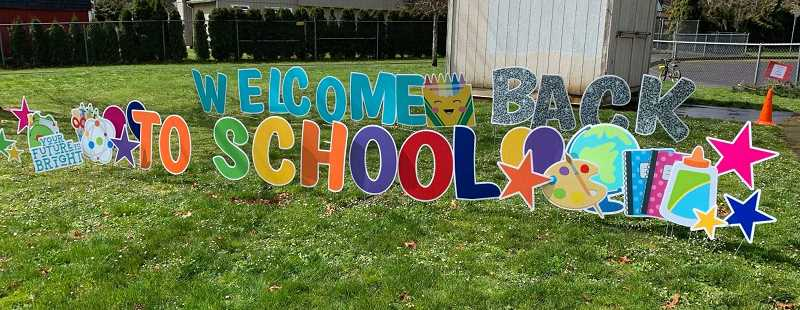 COURTESY PHOTO: OCSD - Oregon City elementary schools welcomed back students with traditional signs, while other new signs reminded kids about hand sanitizing and other protocols to combat COVID-19.