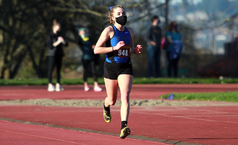 PMG PHOTO: MILES VANCE - St. Mary's Academy senior Fiona Lenth won this cross country race on March 17 at Fernhill Park. She is building for a strong finish to her high school career before heading to Northwestern near Chicago for college.
