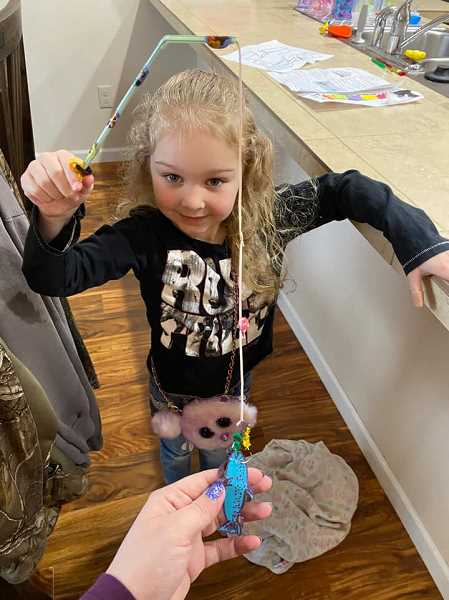 COURTESY PHOTO: ASHLEY KING - Five-year-old Maci Haynes shows her project from a STEM mystery bag distributed by the Scappoose Public Library.