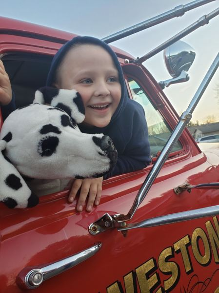 COURTESY PHOTO: BRAD ROE - The Weston firetruck has a stuffed Dalmatian and plays the birthday song over speakers.