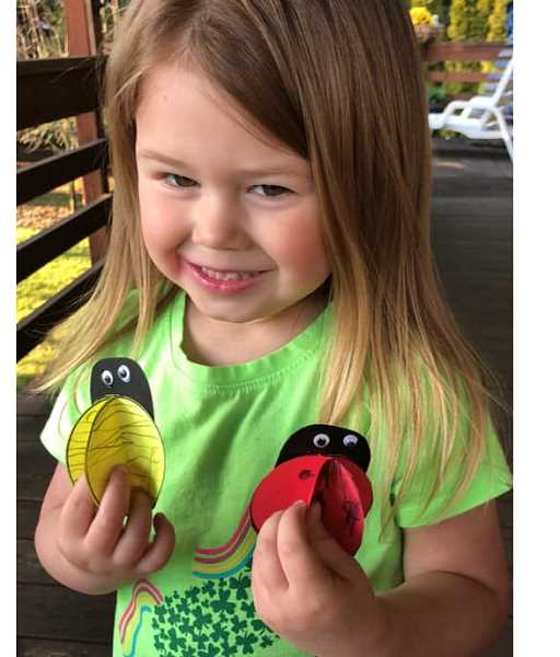 COURTESY PHOTO: KAREN RENEE OYLER - Everly, who is four years old, shows her bug magnets made from one of the Scappoose Library's take-and-make kits.