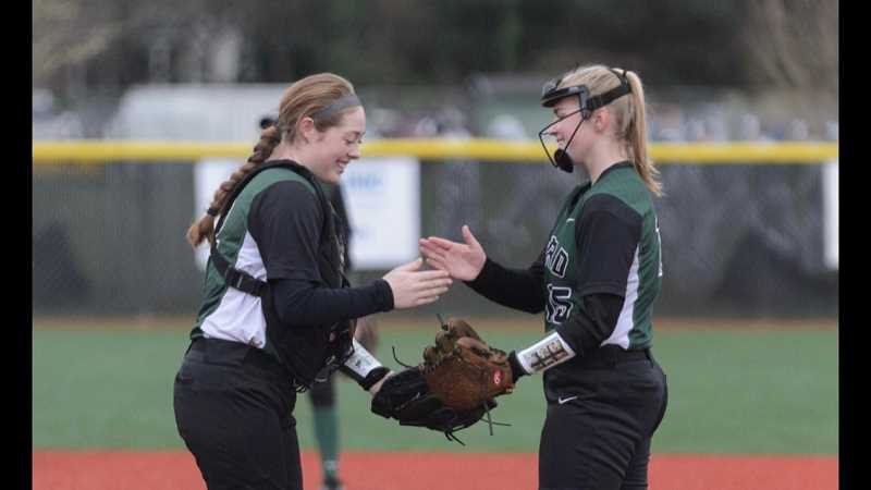 COURTESY PHOTO - Emily Paulson (left) and Sophia vanderSommen celebrate a play during a game in 2019. Paulson missed her senior season due to COVID and is playing softball at Western Washington University, while vanderSommen will be a senior on this year's Tigard team.