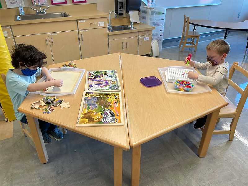 COURTESY PHOTO - Kindergarten students Theo Davis (left) and Jeremiah Morgan experience their first day of in-person learning in Torrie Dowdy's class at the Gladstone Center for Children & Families in April.