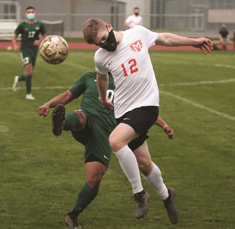 PMG PHOTO: PHIL HAWKINS - A pair of hard-fought soccer matches with North Marion left Molalla just short of capturing the league title this week.