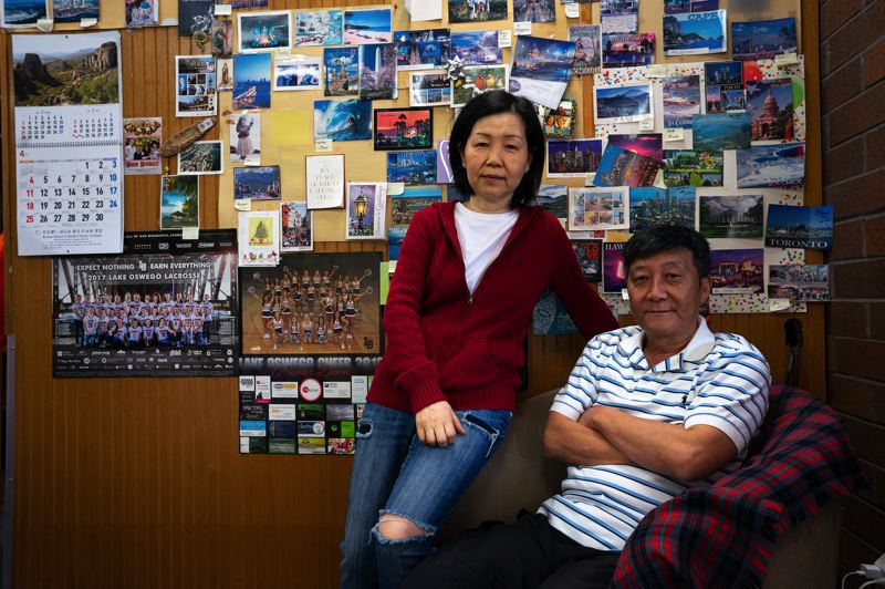 PMG PHOTO: CLARA HOWELL  - Young Kim and Chang Yang are closing Classic Cleaners & Draperies after 15 years in the Lake Grove area.