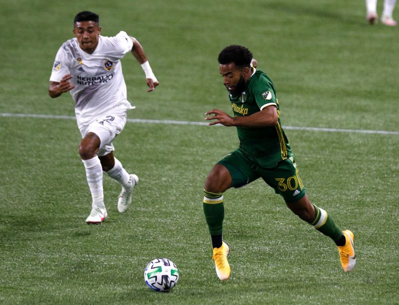 PMG PHOTO: JONATHAN HOUSE - Eryk Williamsons growth during the 2020 season was a key to Portlands success. The 23-year-old midfielder looks to build upon his rolle alongside Diego Chara in midfield.