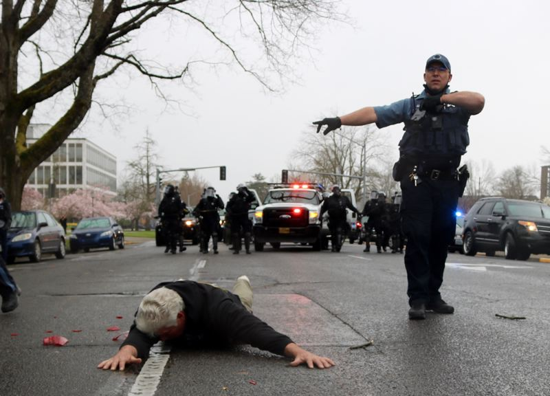 PMG PHOTO: ZANE SPARLING - During a Sunday, March 28, protest outside the state Capitol in Salem, a man pulled a handgun after protesters attacked his car. A bill that just passed the Senate and is heading to the House would ban firearms from inside state buildings, such as the Capitol.