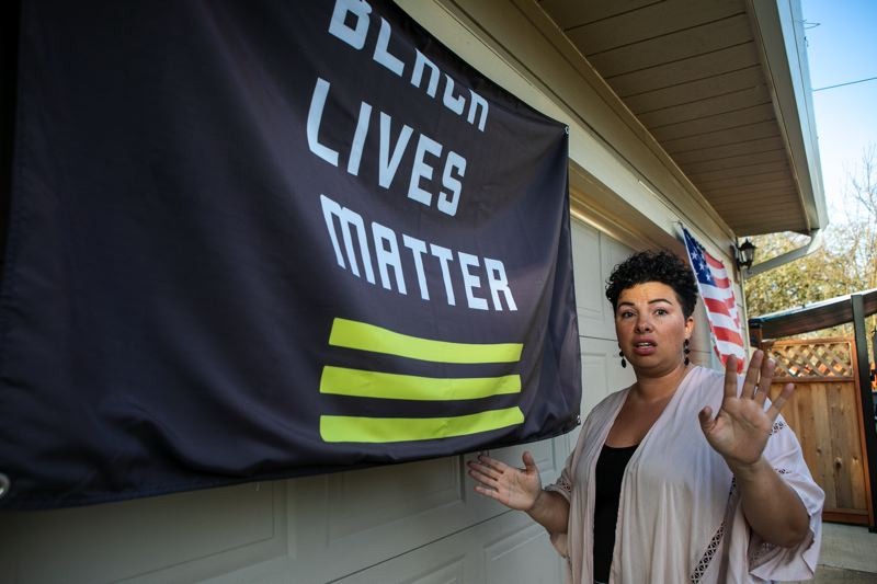 PMG PHOTO: JAIME VALDEZ - Mirella Castaneda and her family have both a Black Lives Matter flag and an American flag adorning their home. The flag is at the center of an off-duty cop's prosecution after a nightime confrontation that left her family shaken.