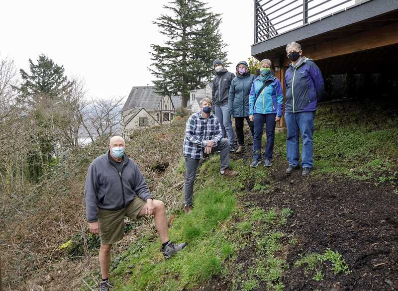PMG PHOTO: JONATHAN HOUSE - Neighbors gather on a steep hillside overlooking a canyon on Southwest Menefee Drive in Portlands Hillsdale neighborhood where a new home is proposed to be built.