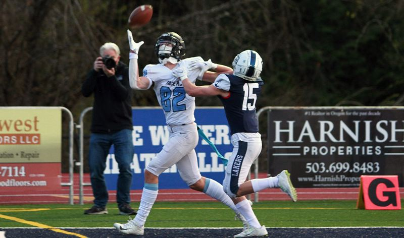 PMG PHOTO: MILES VANCE - Lakeridge freshman wide receiver Joey Olsen makes a one-handed touchdown catch during his team's 35-21 loss to Lake Oswego at Lake Oswego High School on Friday, April 2.