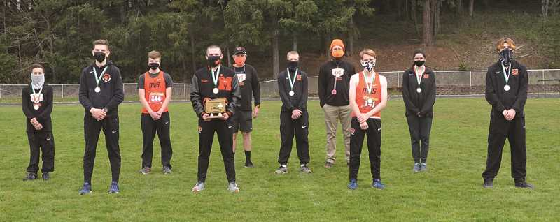 COURTESY PHOTO - The Molalla boys cross country team in the aftermath of their conference championship.
