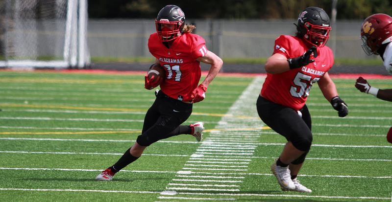 PMG PHOTO: MILES VANCE - Clackamas senior wide receiver Nick Kennewell races upfield during his team's 14-7 loss to Central Catholic at Clackamas High School on Saturday, April 3.