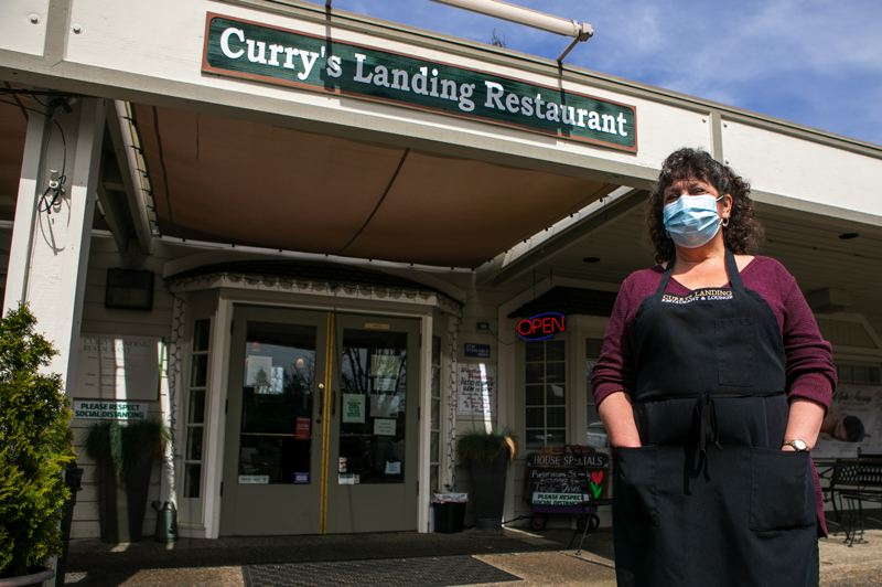 PMG PHOTO: JAIME VALDEZ - The last year has been hard on local restaurants like Curry's Landing in Charbonneau and struggles from the pandemic may continue despite vaccinations. Owner Cindy Grier is pictured here.