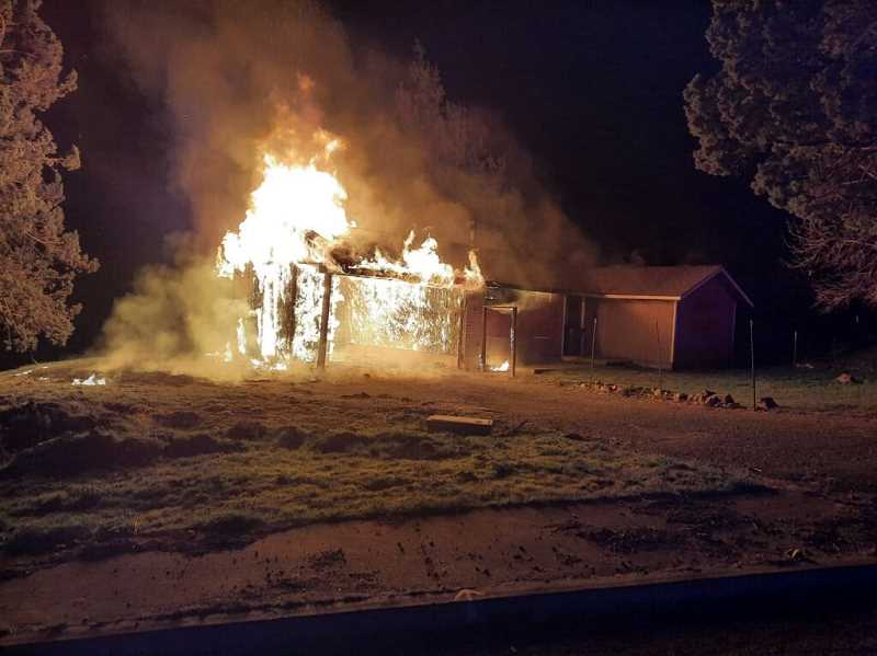 WARM SPRINGS POLICE DEPARTMENT PHOTO - Fire destroyed a vacant home on Bray Avenue in Warm Springs early Friday morning, April 2.