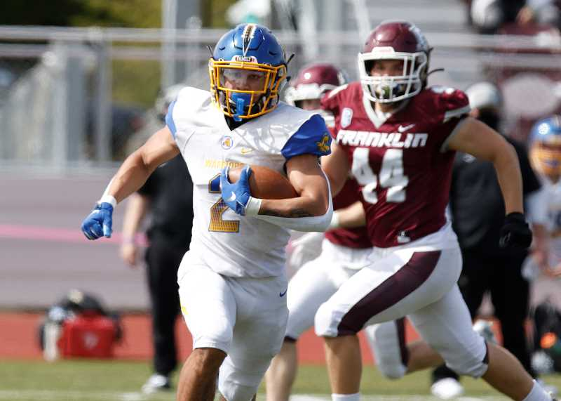 PMG PHOTO: JONATHAN HOUSE - Aloha's Adrian Mashia Jr carries the ball during the Warriors' game against Franklin Saturday afternoon, April 3, at Franklin High School.