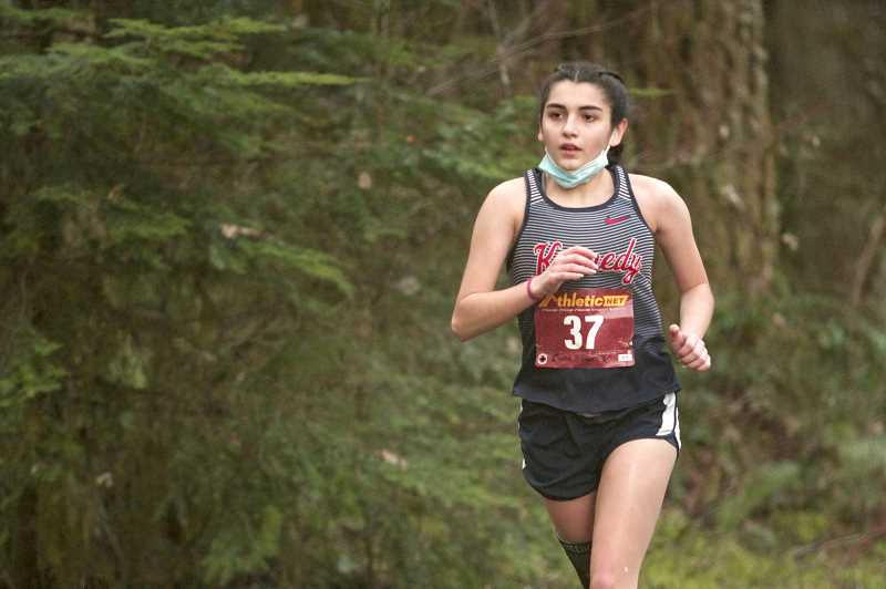 PMG FILE PHOTO - Four-year varsity runner Cassie Traeger led the Trojans with a 10th-place finish with a season-best time of 24:04.10.