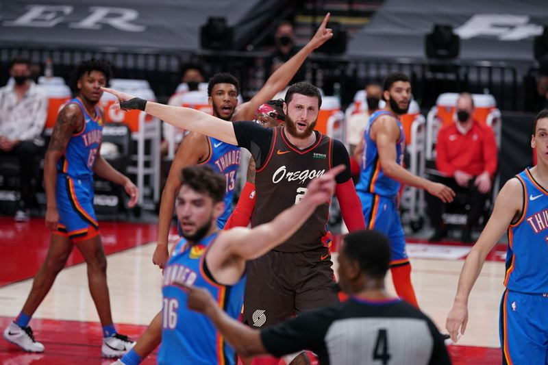 COURTESY PHOTO: BRUCE ELY/TRAIL BLAZERS - Whose ball is it? Everybody had an opinion on this play during the Trail Blazers' game April 3 against Oklahoma City, including Jusuf Nurkic. The Blazers won 133-85.