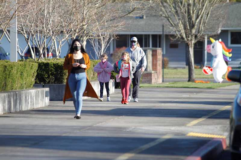 PMG PHOTO: WADE EVANSON - Parents and students return to school at Joseph Gale Elementary School on Monday, April 5. Pre-K through sixth-graders are back as part of a the district's hybrid learning plan.