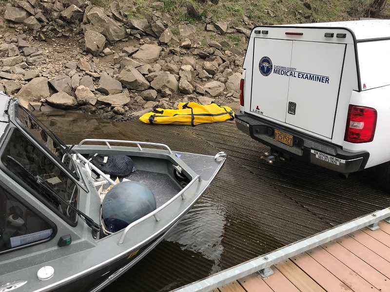 COURTESY PHOTO: CCSO - A Clackamas County Medical Examiner responds to examine the body of Samuel Brooks, who was found submerged in the Willamette River on March 26.
