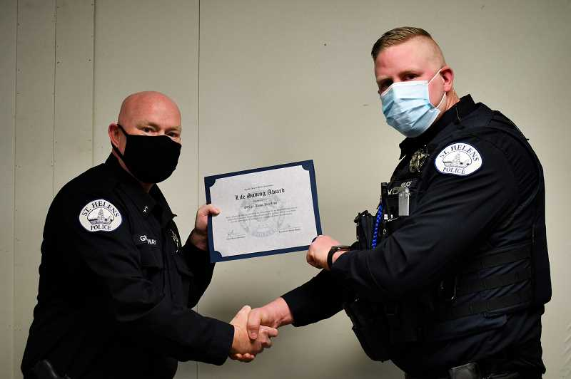 SUBMITTED PHOTO: CITY OF ST. HELENS - St. Helens Police Chief Brian Greenway (left) presents Live Saving Award to officer Adam Hartless.