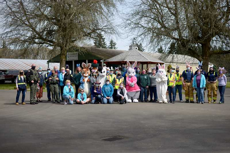 PMG PHOTO: ANNA DEL SAVIO - The egg hunt was carried out with the assistance of dozens of volunteers, who directed traffic, handed out goodie bags and waved to visitors.