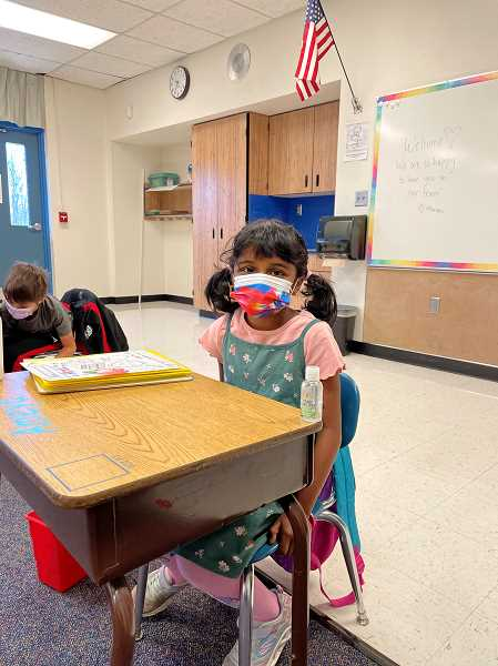 COURTESY PHOTO: BEAVERTON SCHOOL DISTRICT - A student at Elmonica Elementary School sits at her desk thats equipped with hand sanitizer and school supplies. Children are also designated a water bottle to avoid using a communal water fountain.