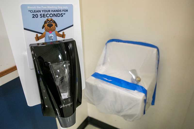 PMG PHOTO: JAIME VALDEZ - A hand sanitizing station and closed off water fountain at Elmonica Elementary School in Beaverton.