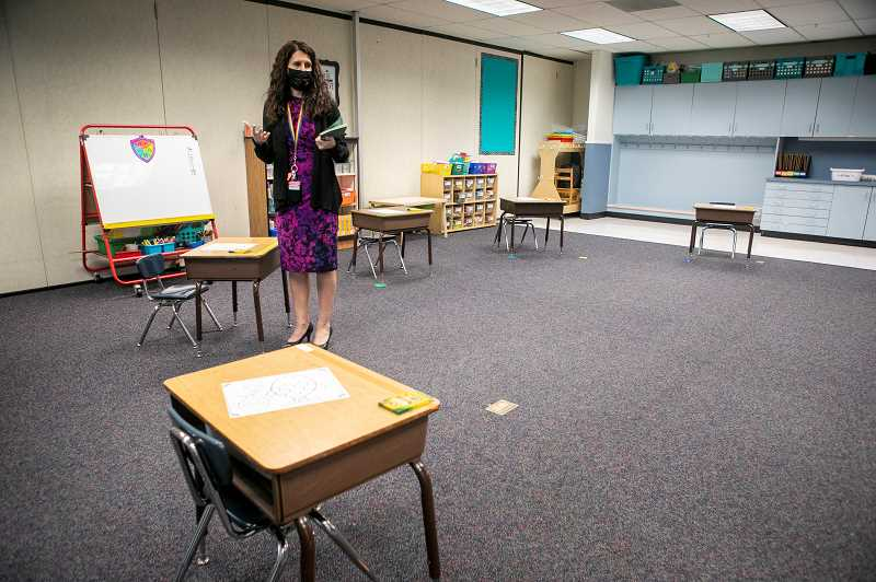 PMG PHOTO: JAIME VALDEZ - Elmonica Elementary School principal Kalay McNamee stands in a classroom where students will be social distancing while they learn.