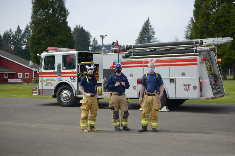 PMG PHOTO: ANNA DEL SAVIO - Bunny-eared members of the Scappoose Fire District greeted visitors at the mEGGa egg hunt.
