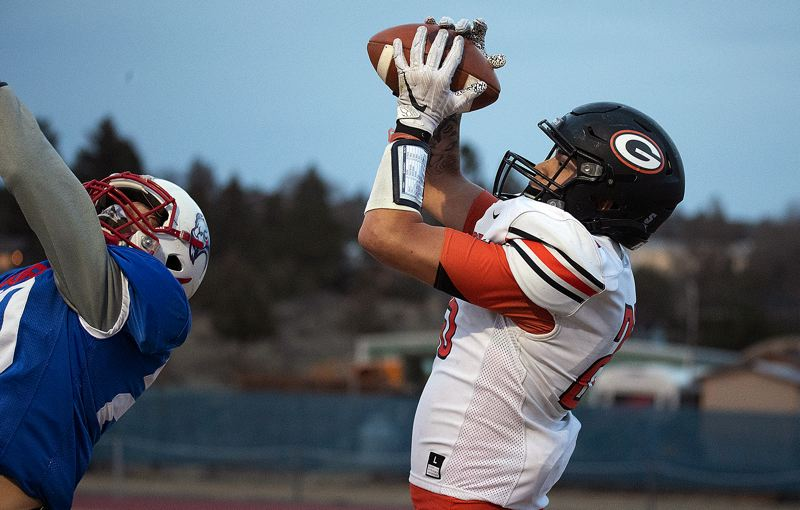 COURTESY PHOTO: LON AUSTIN - Gladstone senior Jude Ashpole hauls in one of his three touchdown catches in his team's 32-6 win over Madras at Madras High School on Friday, April 2.