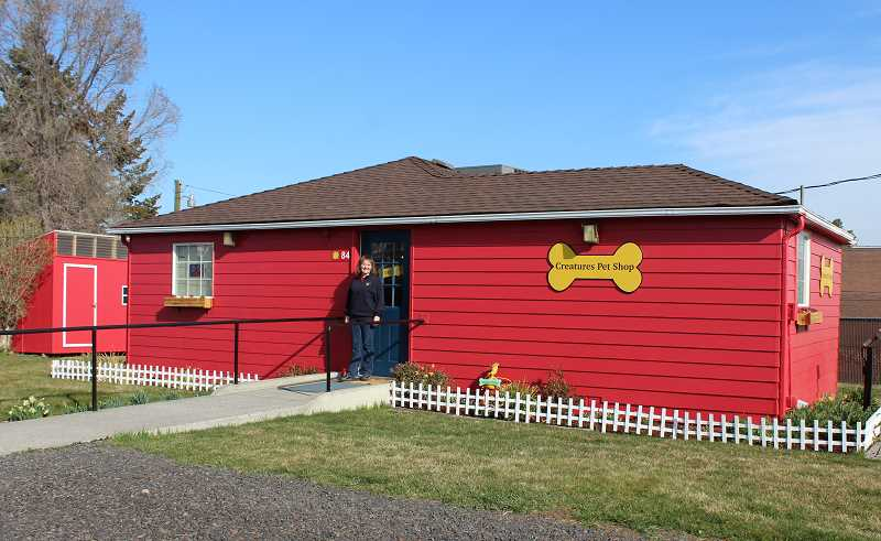 HOLLY SCHOLZ/MADRAS PIONEER   - Creatures Pet Shop owner Michal Smith is transforming the former salon building into a dog-house themed pet shop.
