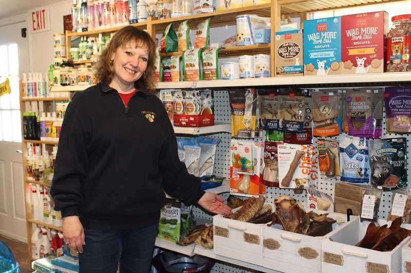 HOLLY SCHOLZ/MADRAS PIONEER   - Michal Smith's shop offers pet food, treats and supplies for dogs, cats, fish, birds, small animals and reptiles as well as a U-Wash service for dogs.