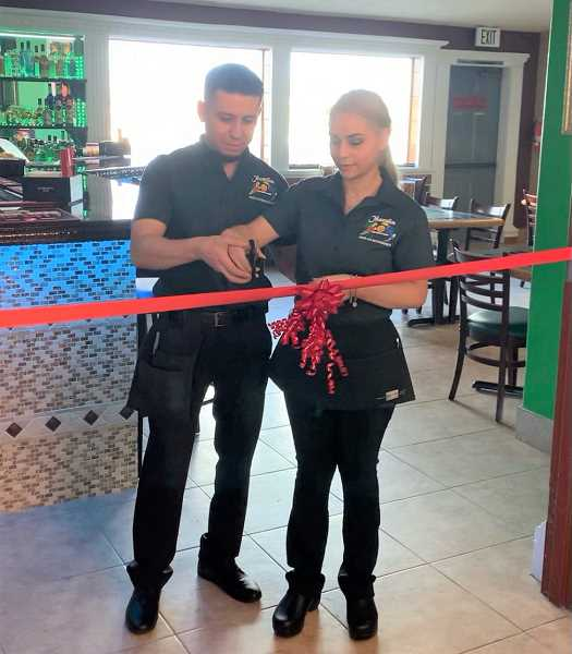 PHOTO COURTESY OF LUIS BASALDUA  - Owners Luis Basaldua and Claudia Toro cut the ribbon on their new bar inside Mazatlan in north Madras.