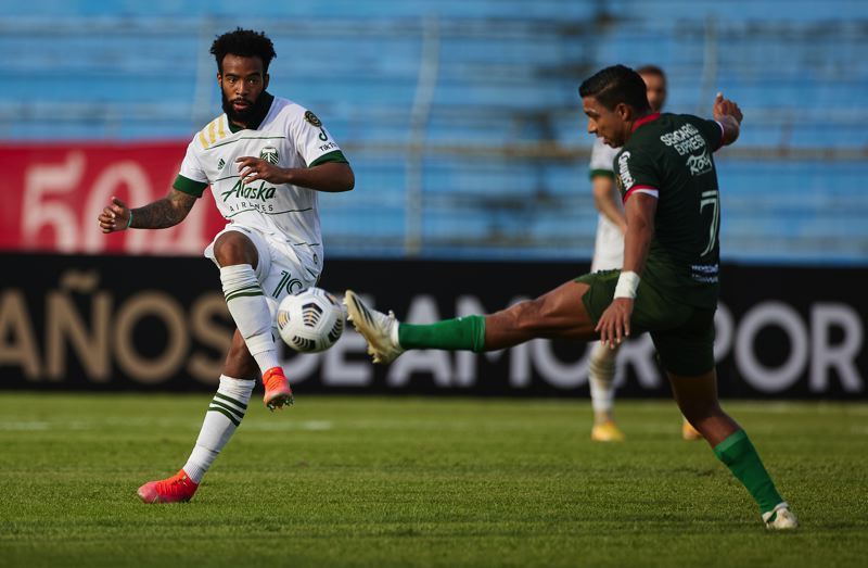 COURTESY PHOTO: CRAIG MITCHELLDYER/PORTLAND TIMBERS - Timbers midfielder Eryk Williamson curls a pass around a C.D. Marathon player on Tuesday, April 6 in a Concacaf Championsh League match at San Pedro Sula, Honduras.