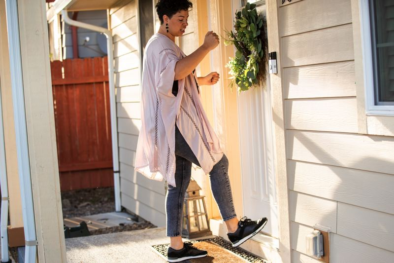 PMG PHOTO: JAIME VALDEZ - Mirella Castaneda recently demonstrated how she she said off-duty Forest Grove police officer Steven Teets was pounding and kicking on the door of her home in the early morning of Halloween 2020.