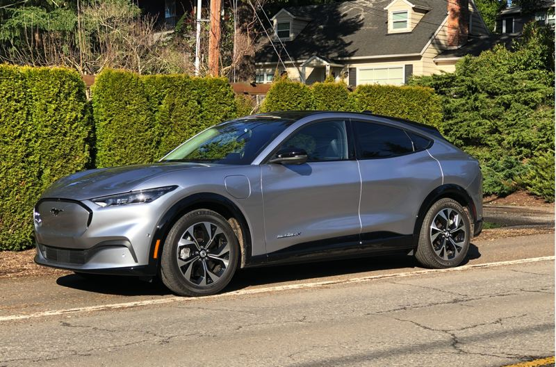 PMG PHOTO: JEFF ZURSCHMEIDE - The exterior lines of the 2021 Mustang Mach-E evoke the iconic Ford Pony Car, while the midsize crossover design offers more comfort and practicality. And the all-electric powertrain delivers stunning performance.