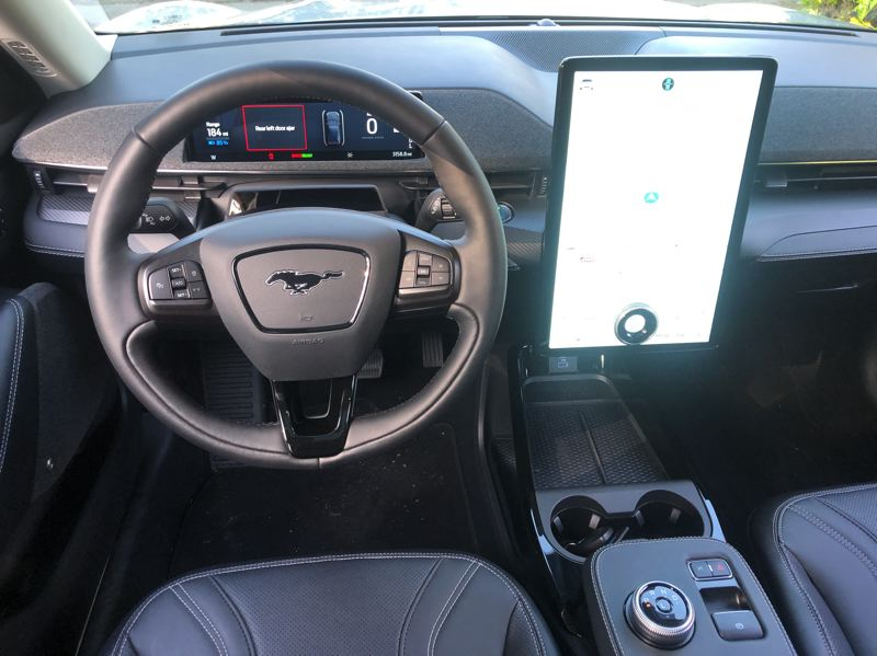 PMG PHOTO: JEFF ZURSCHMEIDE - The interior of the 2021 Mustang Mach-E is clean and simple, with most of the tech delivered through a massive tablet mounted on the dash.
