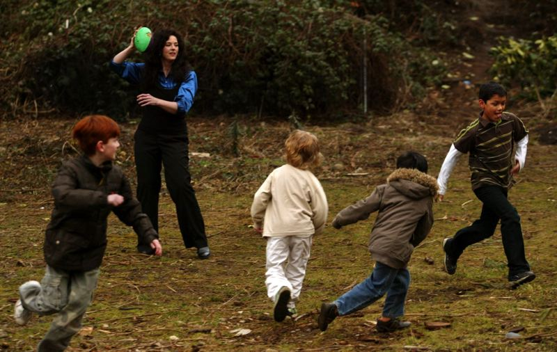 FILE - Tamara Boyd readies to make a pass to her foster son Joe, 11, while playing football with his siblings (from right) Anthony, 7, Julian, 5, and Gabriel Wagner, 11, in 2009.