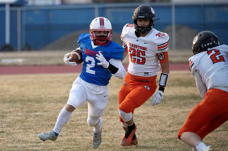 LON AUSTIN  - Cael White cuts upfield against Gladstone April 2. White made a leaping catch of a 21-yard Dru Boyle pass for a touchdown in the second quarter of the 32-6 Buff loss.