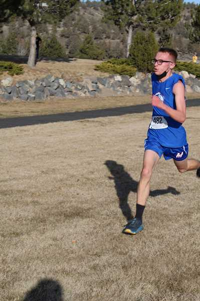 TONY AHERN  - Grayson Symons, shown earlier in the season, finished fourth at the Tri-Valley Conference meet to earn a spot at Saturday's state cross-country championships. Freshman Talize Wapsheli took fifth in the girls race to make state for the Buffs as well.