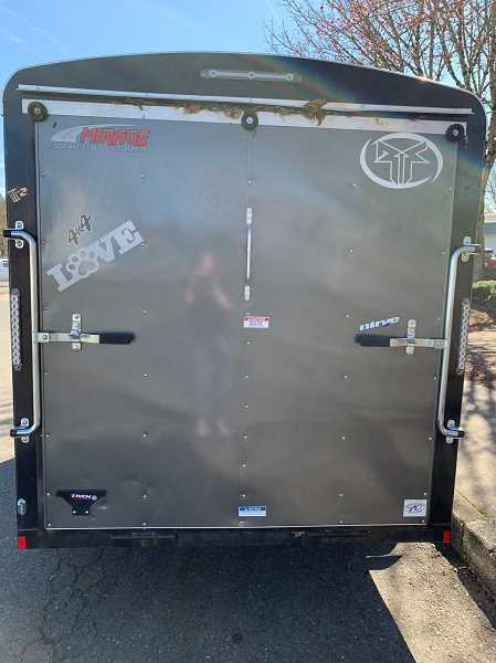 COURTESY PHOTO: CANBY POLICE - The stolen trailer has distinct stickers on the sides and the back.
