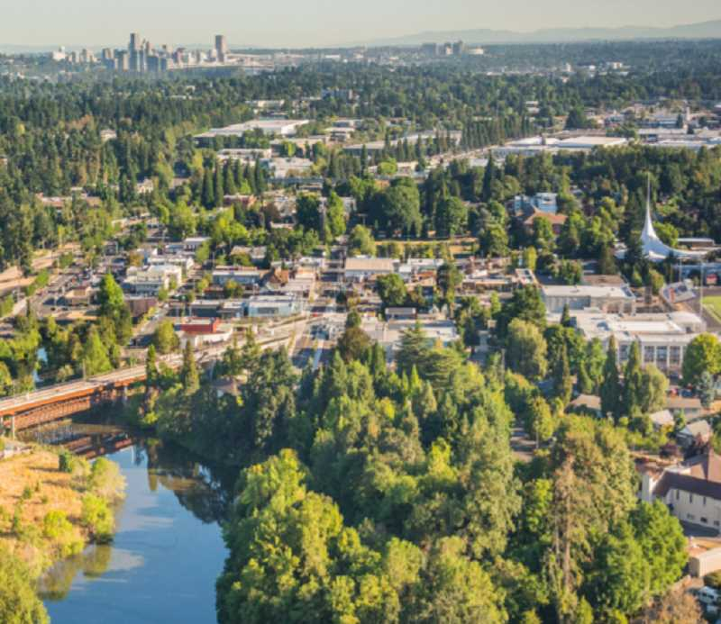 COURTESY PHOTO - Milwaukie's urban tree canopy is visible in the aerial view facing north from Kellogg Lake, with Portlands skyline in the background.