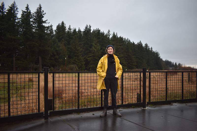 PMG PHOTO: TERESA CARSON - Barbara Kinzie Christman is one of the residents who objects to the Headwaters project in Southwest Gresham. The 30-home development would require removal of 250 mature fir trees, which abutt a undeveloped park and two wetland areas.